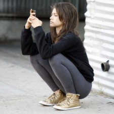 Zendaya seen relaxing for the cameras during a break at the dance studio. At one point she is seen texting and having a good time.   Pictured: Zendaya  Ref: SPL544065  150513   Picture by: Phamous / Splash News  Splash News and Pictures Los Angeles:310-821-2666 New York:212-619-2666 London:870-934-2666 photodesk@splashnews.com